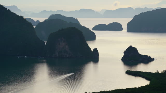 4k footage scene of Fantastic Landscape of Samed Nang Chee view point with boating at the sunrise time, Nature Travel and holiday concept