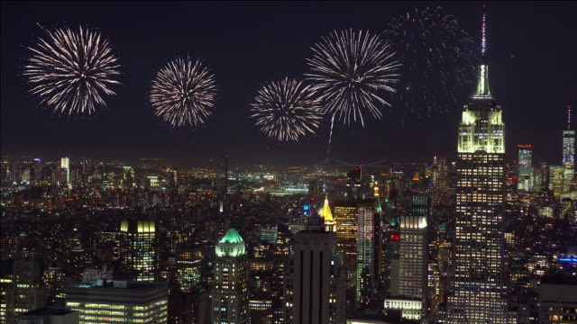 4k footage scene of firework over new york cityscape, united states, independence day concept - firework display stock videos & royalty-free footage