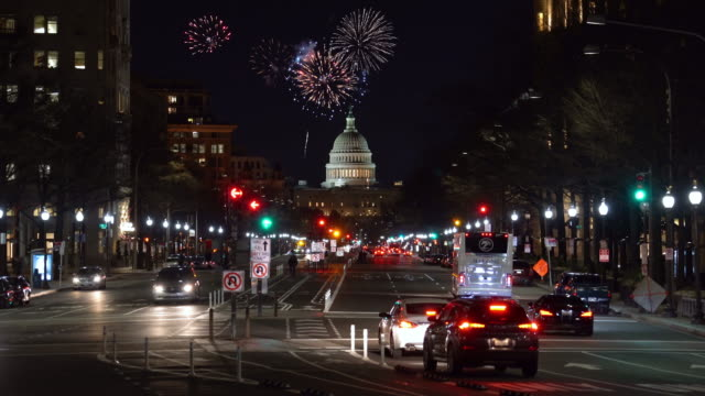 4k footage scene of firework over the united states capitol building cityscape at night, washington, d.c., united states, independence day concept - fourth of july stock videos & royalty-free footage