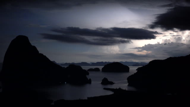 4k footage scene of lightning with thunderstorm clouds of samed nang chee view point at night time, phangnga, thailand, nature travel and landscape concept - evil stock videos and b-roll footage
