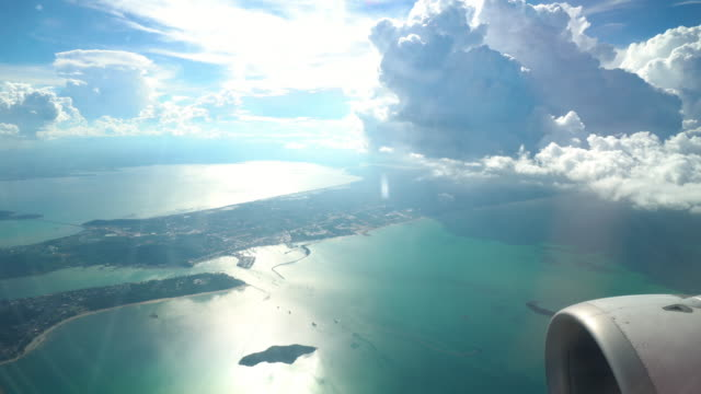 4k footage scene of looking out the window seeing wonderful view mountain and see from airplane flying in the sky through clouds, Travel and transportation concept