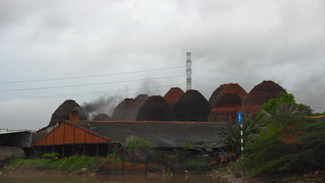 4k footage scene of smoke from kiln at mang thit the land of bricks, vinh long province, vietnam, culture and constructure concept - kiln stock videos and b-roll footage