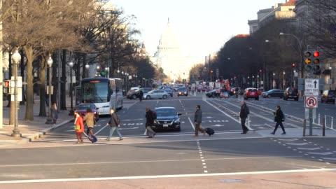 4k footage scene of the united states capitol building with pedestrian and traffic road in rush hour, pennsylvania, capitol hill, washington, d.c., usa, landmark and architecture concept - capital cities stock videos & royalty-free footage