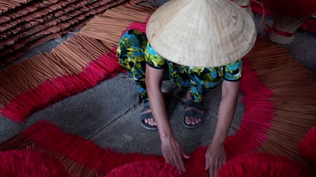 4k footage scene of vietnamese woman arranging incense stick on floor at the old traditional house in south of vietnam, traditional art and culture concept - south vietnam stock videos & royalty-free footage