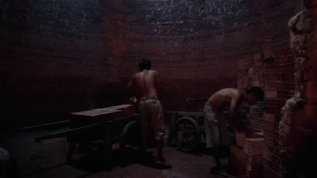 4k footage scene of workers transporting and loading bricks in side of kiln at mang thit the land of bricks, vinh long province, vietnam, culture and constructure concept - tradition stock videos & royalty-free footage