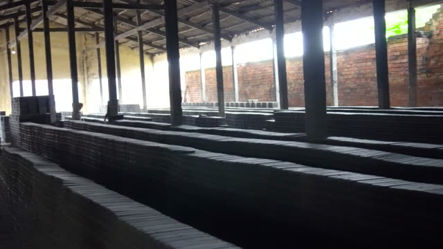 4k footage scene stack of bricks in brick factory at mang thit the land of bricks, vinh long province, vietnam, culture and constructure concept - kiln stock videos and b-roll footage