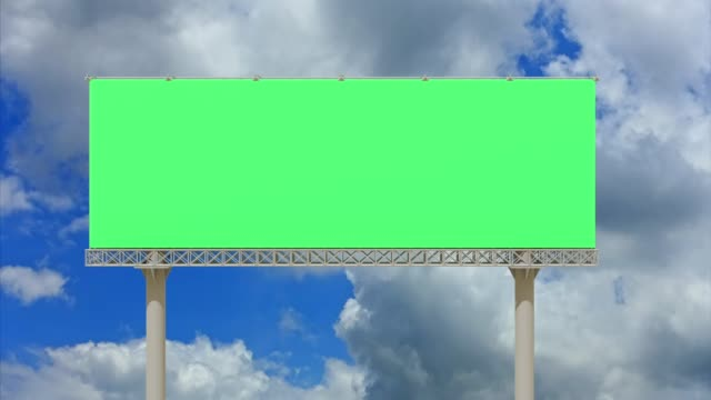 4k footage,empty billboard with chromakey green screen on time lapse cloud and blue sky.advertisement billboard concept. - poster design stock videos and b-roll footage