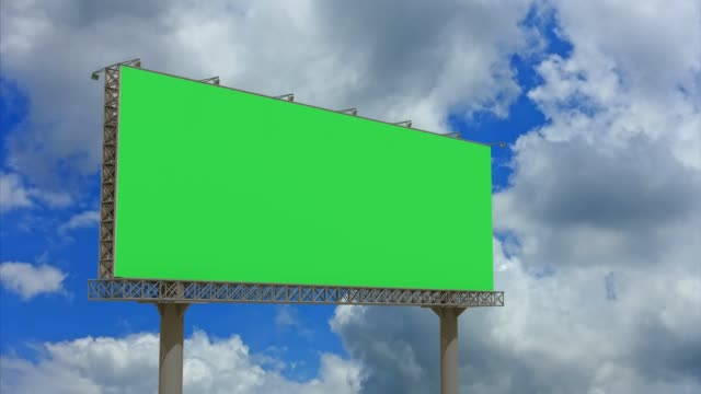 4k footage,empty billboard with chromakey green screen on time lapse cloud and blue sky.advertisement billboard concept. - poster stock videos & royalty-free footage