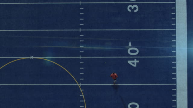 4k Football Player running towards end zone. Overhead aerial stock footage