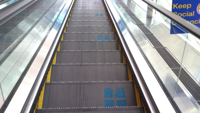 4k footprint sign for standing in escalators to avoid infection of coronavirus disease - footprint stock videos & royalty-free footage