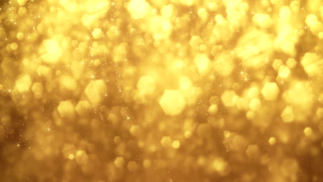4k gold particles background animation - loopable - gold colored stock videos & royalty-free footage
