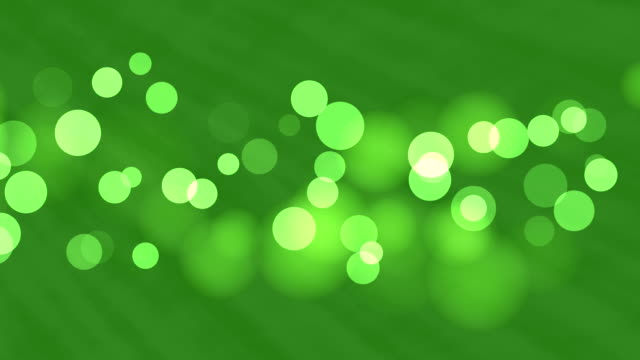 4k green bokeh abstract light background - glowworm stock videos & royalty-free footage