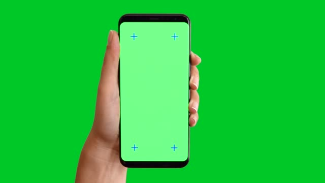 4k hand using smart phone displaying chroma key on green screen - human hand stock videos & royalty-free footage