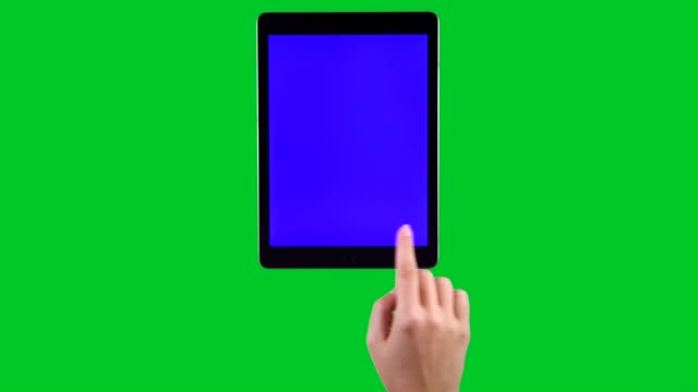 4k hand using tablet pc displaying chroma key on green screen - vertical stock videos & royalty-free footage