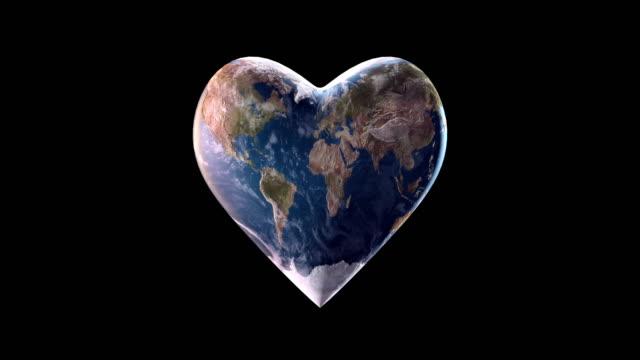 4k hjärtformade jorden (svart bakgrund) - slinga - ansvarsfullt företagande bildbanksvideor och videomaterial från bakom kulisserna