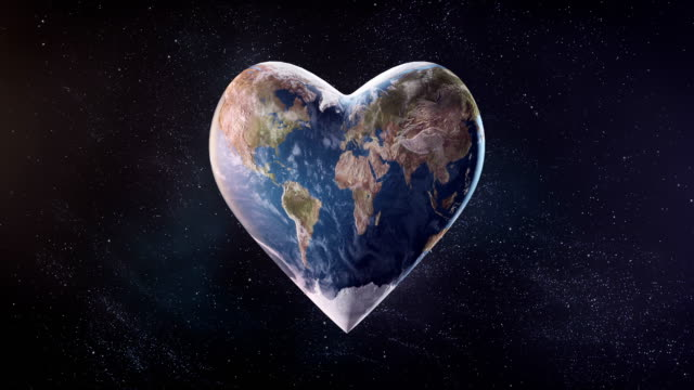 4k heart-shaped earth (space background) - loop - charity benefit stock videos & royalty-free footage