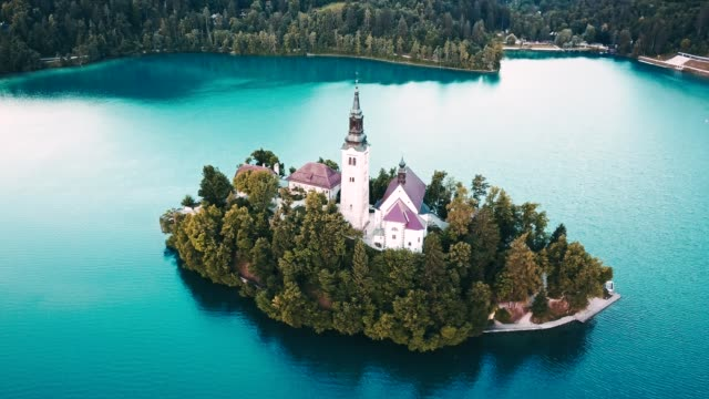 4k helicopter view of the bled lake in slovenia - slovenia stock videos & royalty-free footage