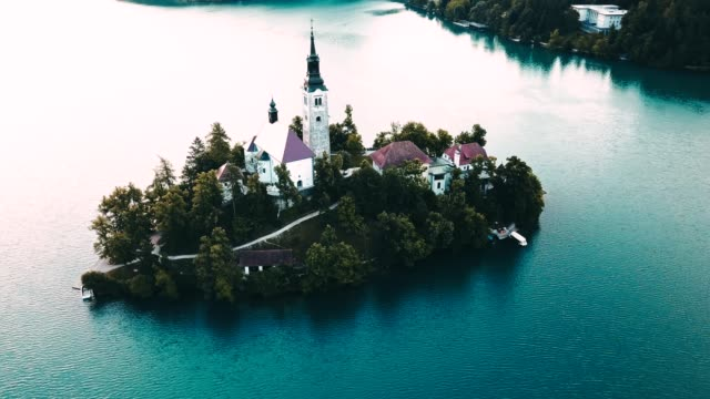 4k helicopter view of the bled lake in slovenia - lake bled stock videos & royalty-free footage