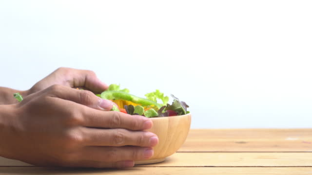 4k holding and lay salad bowl on white background.