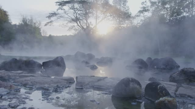 4k ,hot spring water in sunrise - thermal pool stock videos & royalty-free footage
