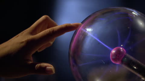 4k, human hand touching and catching a plasma ball. - plasma ball stock videos & royalty-free footage