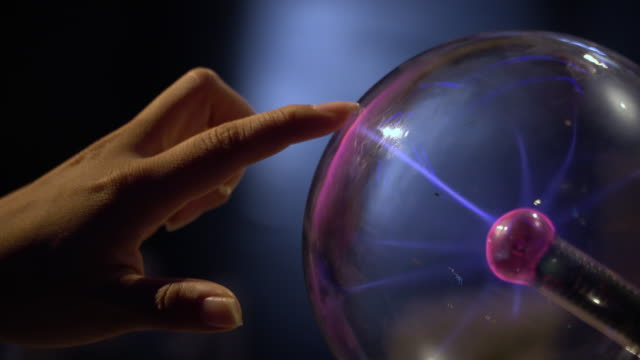 4k, Human hand touching and catching a plasma ball.