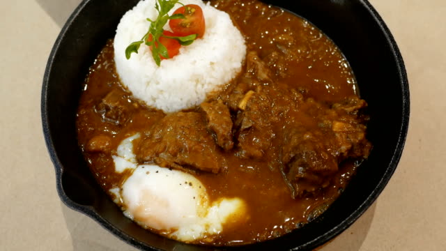 4k japanese curry rice with meat and egg - curry powder stock videos and b-roll footage