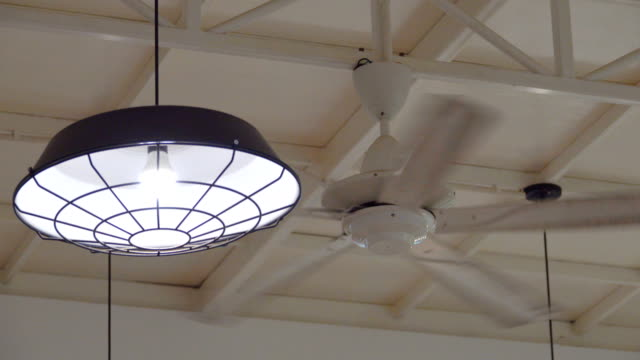 4k: lamp and propeller fan in a room - household fixture stock videos and b-roll footage