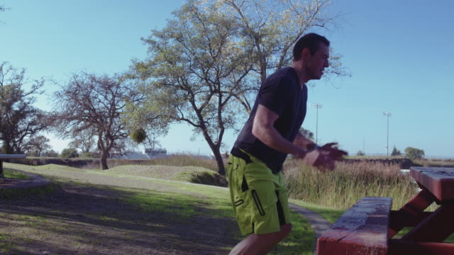 4k middle aged athlete doing box jumps - 40 44 years stock videos and b-roll footage