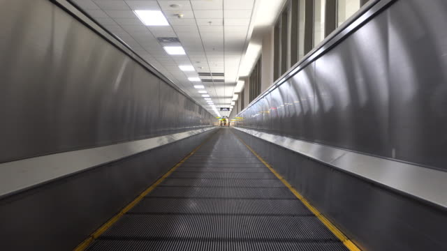 4k moving on flat escalators in airport