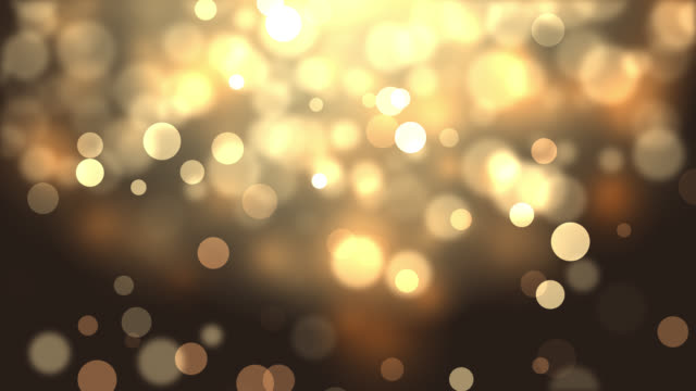 4k moving particles loop - abstract christmas background - gold colored stock videos & royalty-free footage