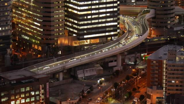 4k nachtsicht verkehr von osaka stadtansichten - hoch allgemeine beschaffenheit stock-videos und b-roll-filmmaterial