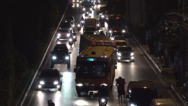 4k: Night with driving on busy multiple lane traffic
