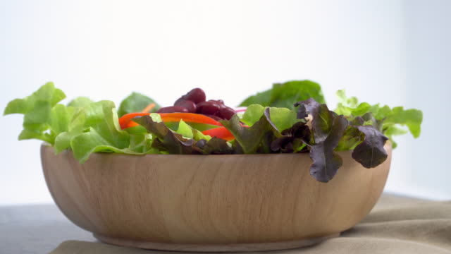 4k of rotate or turning salad bowl. - salad bowl stock videos & royalty-free footage
