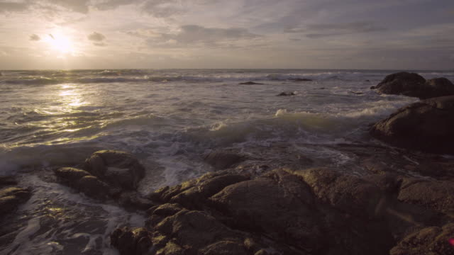 4k of sea beach and stone with sunset. - high dynamic range imaging stock videos and b-roll footage