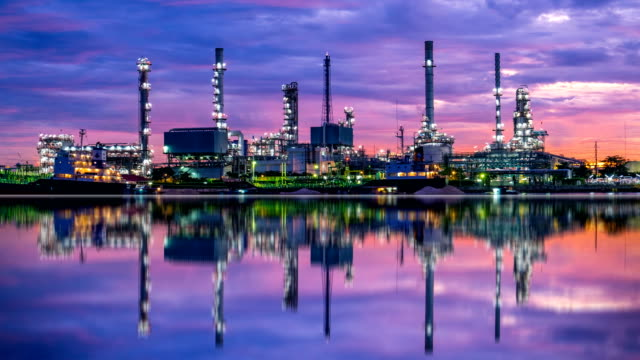 4k oil refinery - petrochemical plant timelapse at sunrise with reflection - chemical stock videos & royalty-free footage