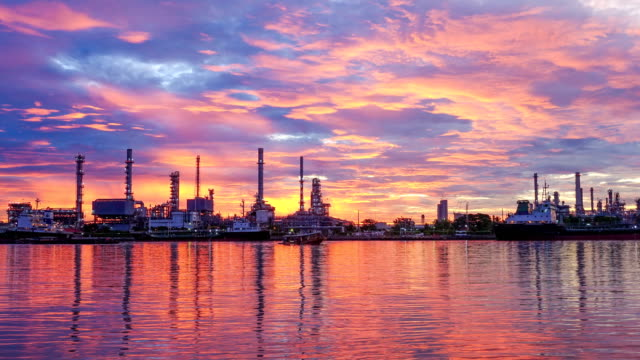 4k oil refinery - petrochemical plant timelapse at sunrise with reflection - pipeline stock videos and b-roll footage