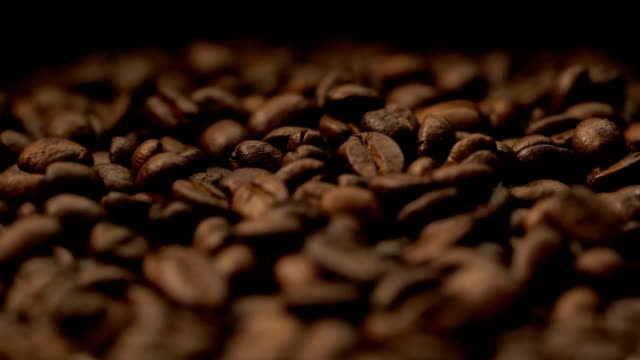 4k on coffee bean .conceptual - cereal plant stock videos & royalty-free footage