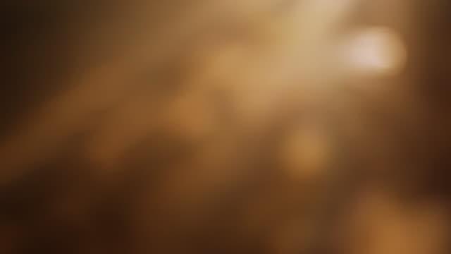 4kオレンジボケ抽象的な光の背景 - light beam点の映像素材/bロール