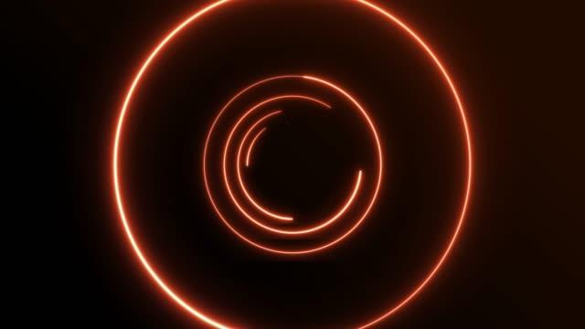 4k orange neon circle lights background - orange colour stock videos & royalty-free footage