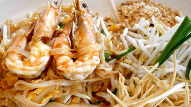 4k pad thai with shrimps - peanut food stock videos & royalty-free footage