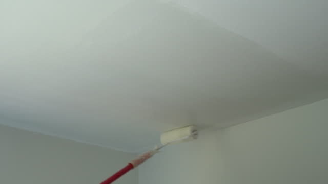 4k : paint in white ceiling with paint roller - ceiling stock videos & royalty-free footage