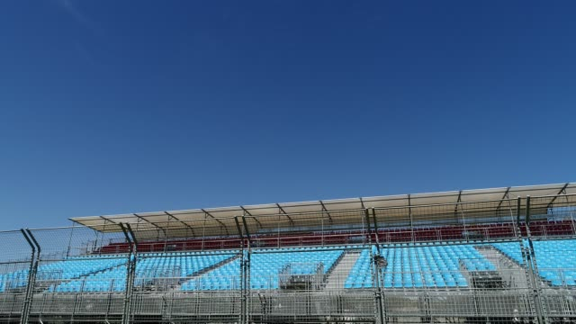4k pan across f1 grand stand seats, albert park, melbourne - standing water stock videos & royalty-free footage
