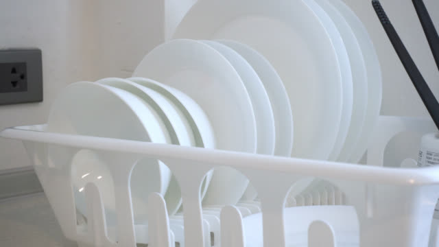4k Pan shot of white Dish rack