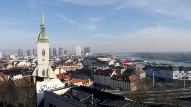 4k panning shot of the bratislava skyline cityscape in slovakia. st. martin's cathedral and castle view - slovakia stock videos & royalty-free footage