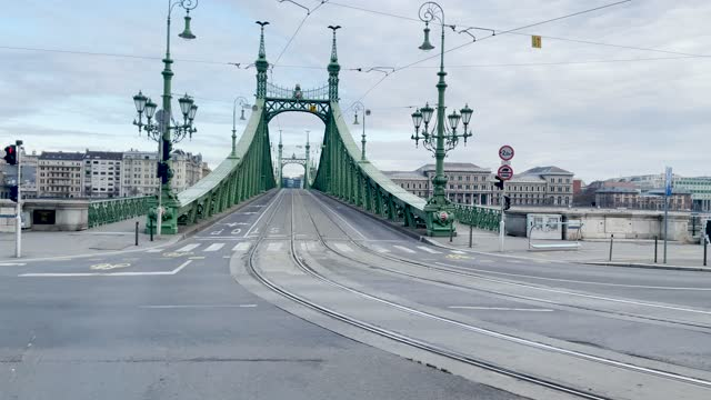 4k panning style budapest bridge traffic scene shot through the window of a moving tram along the waterside, hungary - széchenyi chain bridge stock videos & royalty-free footage