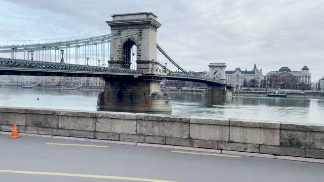 4k panning style budapest city chain bridge and river danube scene shot through the window of a moving tram along the waterside, hungary - hungary stock videos & royalty-free footage