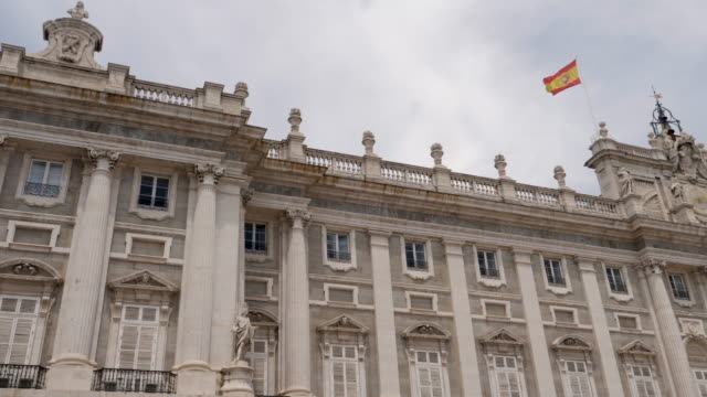 4k panning view of royal palace of madrid architecture and facade. bright sunny conditions - palace stock videos & royalty-free footage