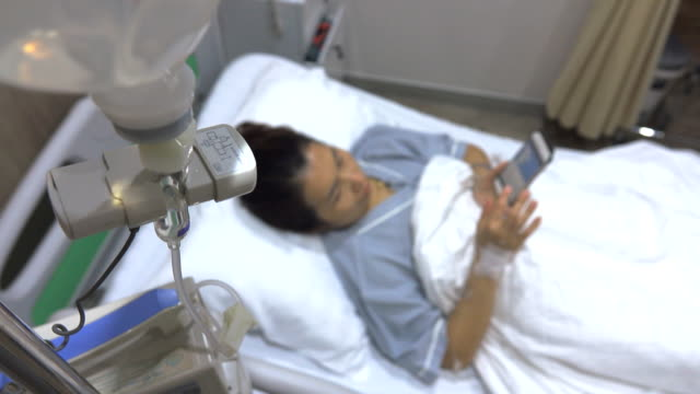 4k: patient in hospital with saline solution volumetric infusion pump - cancer astrology sign stock videos and b-roll footage