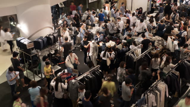 4k people shopping for clothes in shopping mall - top garment stock videos & royalty-free footage